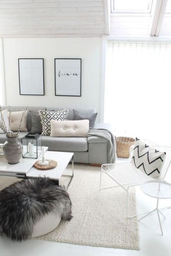printed pillows make the space catchier, a faux fur throw and a comfy rug add coziness