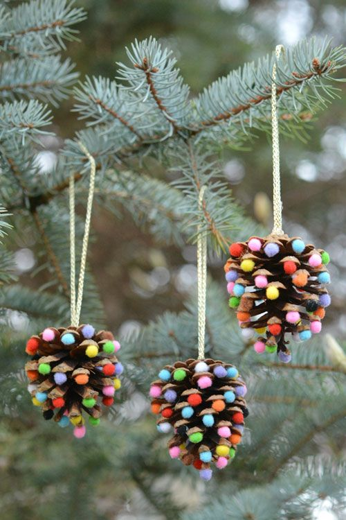 take large pinecones and glue some colorful pompoms to them   these are fun and natural Christmas decorations