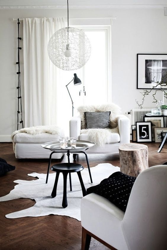 a faux sheepskin, faux fur and leather are ideal to make Scandinavian spaces catchier and cozier