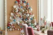 15 a large Christmas tree on canvas with a vintage frame is shaped only of colorful vintage ornaments for a chic look