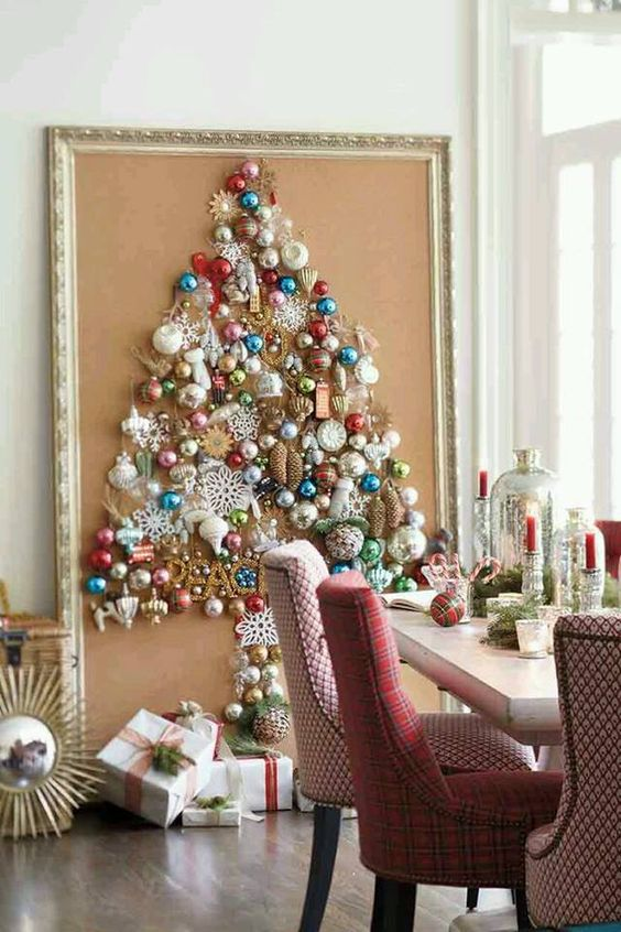 a large Christmas tree on canvas with a vintage frame is shaped only of colorful vintage ornaments for a chic look