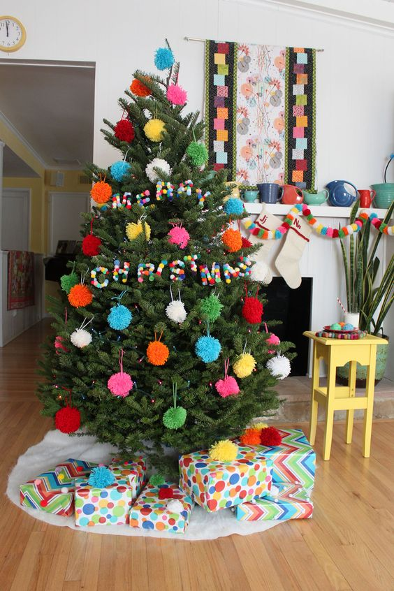 all pompom Christmas tree decor with ornaments and pompom letters for fun, so budget-friendly