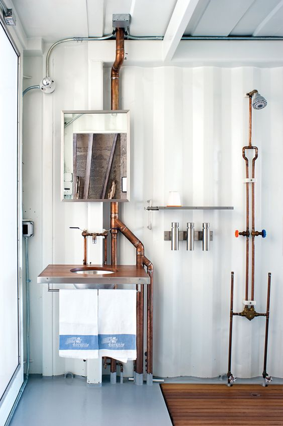 bathroom with exposed pipes