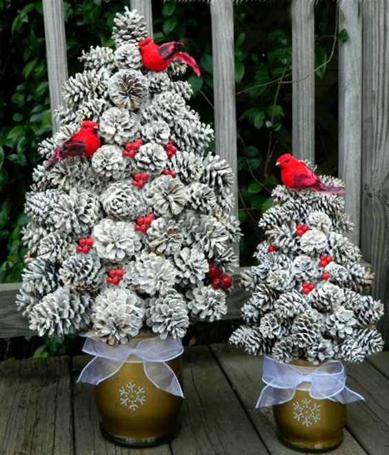 snowy pinecone Christmas trees in cool snowflake pots, fake red berries and birds are amazing for porch decor
