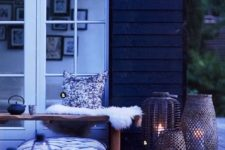 16 a Scandinavian space with lots of candle lanterns, pillows and faux fur for a real hygge feeling
