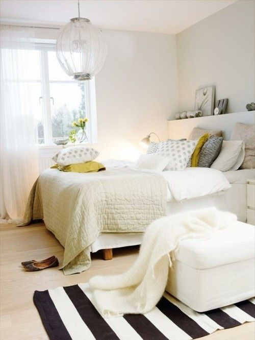a gender neutral bedroom in neutrals with much texture and touches of yellow that fit both men and women easily