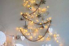 16 attach some wire or yarn right to the wall, add ornaments to shape a tree and add lights