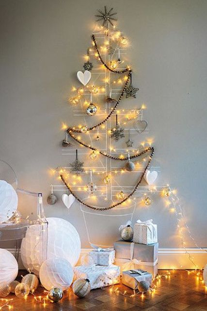 attach some wire or yarn right to the wall, add ornaments to shape a tree and add lights