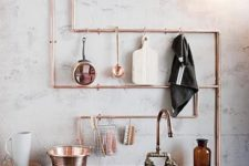 16 exposed copper piping doubles as utensil storage in this industrial kitchen