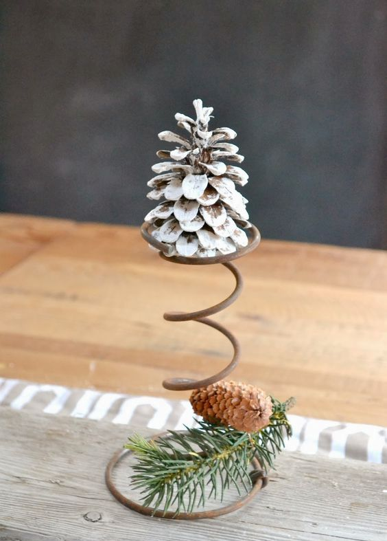 a snowy pinecone on a wire stand plus a usual one with evergreens cna be a nice rustic decoration