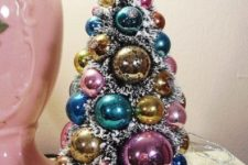 18 a chic pastel Christmas tree of ornaments with faux fur in between is a cool idea for a shabby chic interior