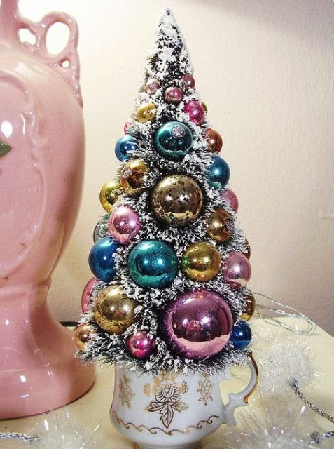 a chic pastel Christmas tree of ornaments with faux fur in between is a cool idea for a shabby chic interior