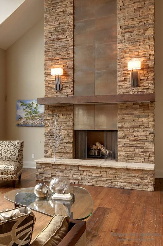a faux stone clad fireplace with metal incorporated is ideal for a modern rustic living room