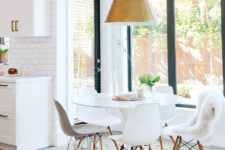 18 keep the eat-in area in the same style as the kitchen and let yourself enjoy the views
