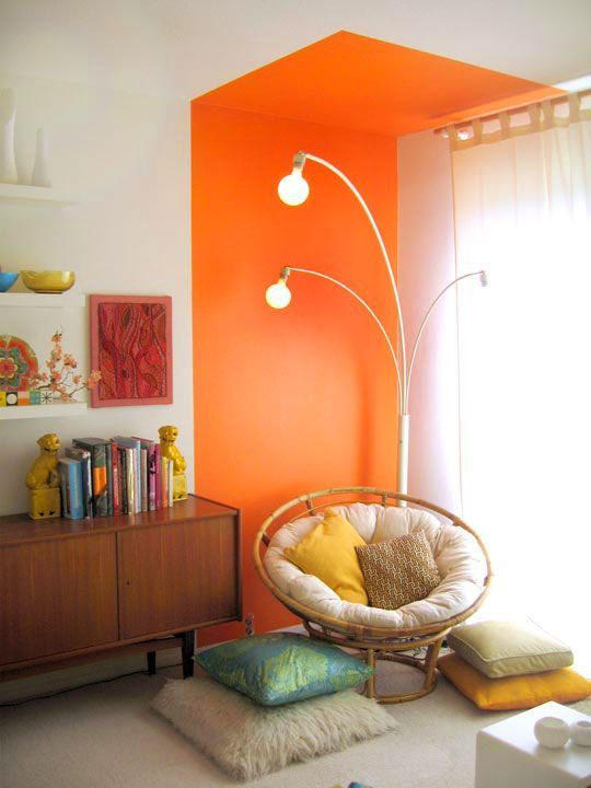 lots of pillows and soft upholstery plus a colorful accent here make the reading nook special
