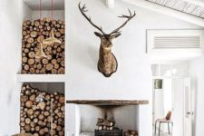 19 a fireplace and firewood storage by its side for a modern yet rustic space, a sisal rug and whitewashed wood