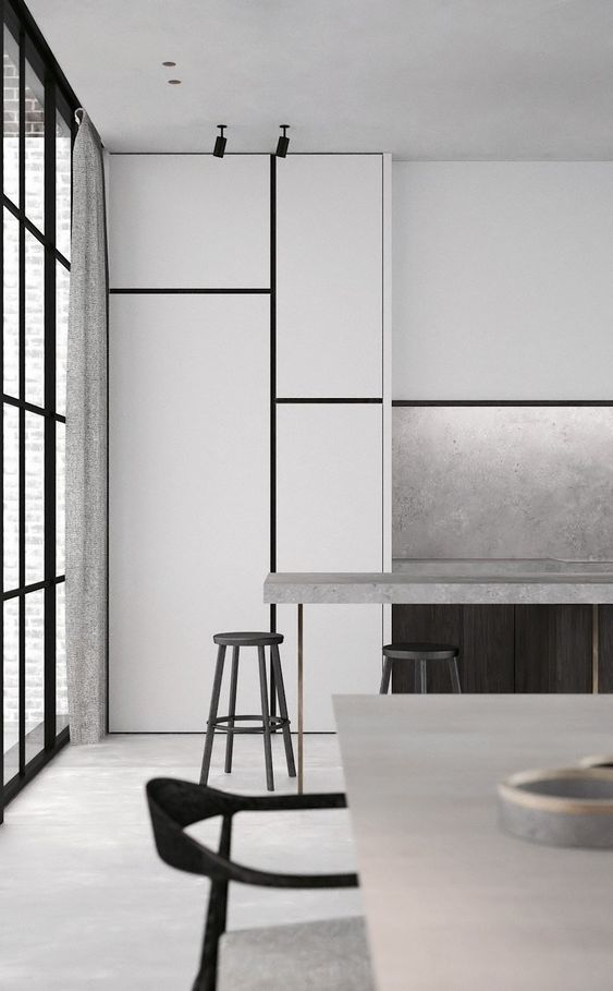 a minimalist kitchen with white cabinets and touches of concrete here and there to make it functional and catchy