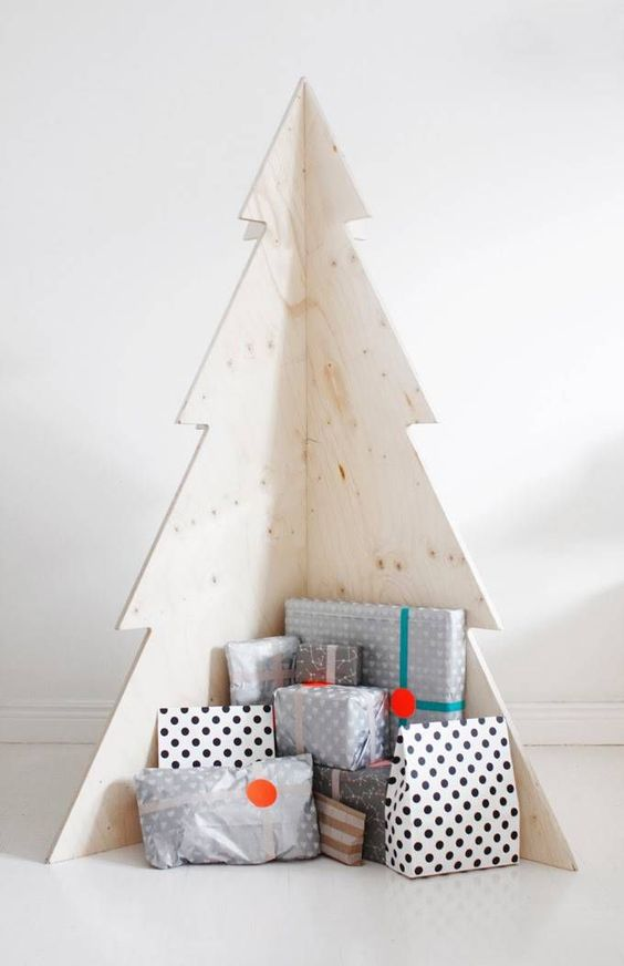 a simple plywood Christmas tree is great for Scandinavian spaces, it doesn't require any decorating at all