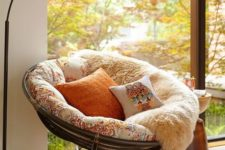 19 colorful pillows, faux fur throws and rugs make the nook super welcoming, the catchy lamps adds even more