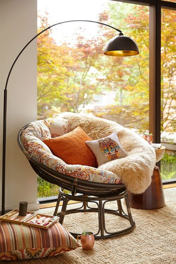 colorful pillows, faux fur throws and rugs make the nook super welcoming, the catchy lamps adds even more
