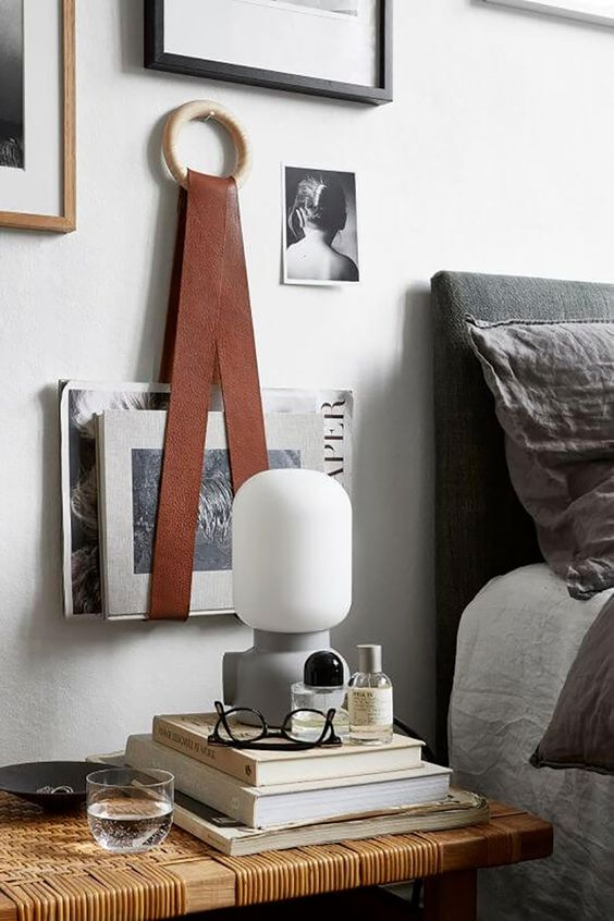 a faux leather strap is used for hanging some books to save the space, it's a very original option