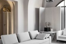 20 a neutral minimalist living room with clean-lined furniture and an accent lamp mixing modern and vintage