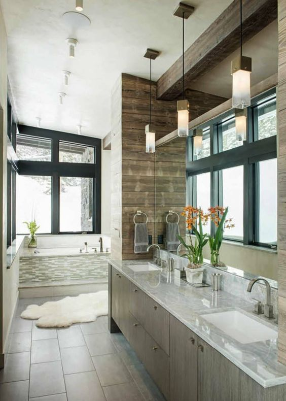 even bathrooms in a modern rustic home should feature large windows to fill it with light
