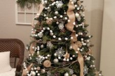 21 a chic Christmas tree with white snowflakes, ball ornaments, twigs, pompomg garlands, burlap ribbons and vine ornaments