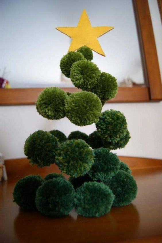 a fun green pompom Christmas tree made on wire with a gold felt star on top is a great alternative to a usual tree
