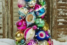 21 a super colorful and vintage Christmas tree made of ornaments and beads on a tray is a creative idea