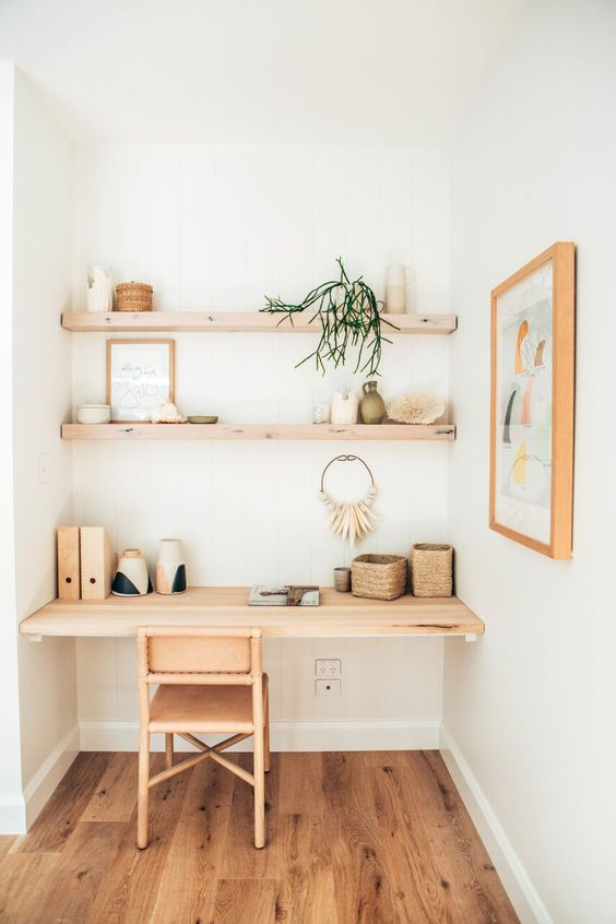 a wooden floor, shelf desk and shelves cozy up this home office nook at once