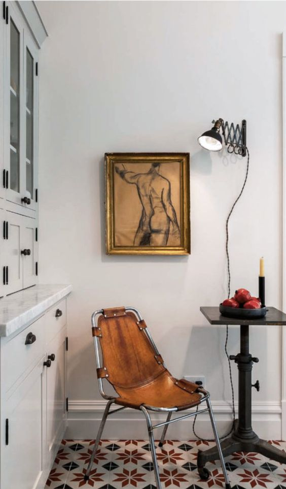 an industrial leather chair is a great way to add a masculine touch to your space, you can even DIY it