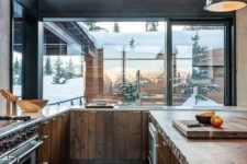 22 a modern rustic kitchen with stained wooden cabinets, ceiling and floor is a fine example of the style