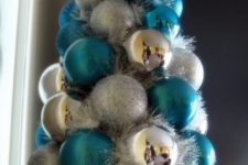 22 a whimsy and colorful Christmas tree of shiny and glitter and blue ornaments plus garlands iis an easy DIY