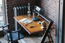22 an industrial desk of wood and metal looks rather masculine and vintage