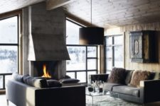 23 a modern chalet is an ideal example of a modern rustic space, done with wood, fur and stone
