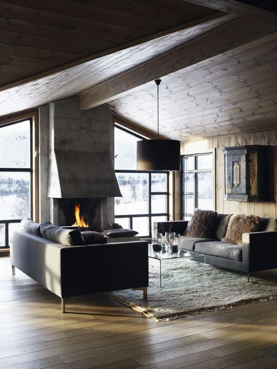 a modern chalet is an ideal example of a modern rustic space, done with wood, fur and stone