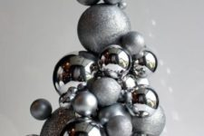 23 a whimsy Christmas tree of shiny and glitter silver ornaments can be easily DIYed and used as a tabletop one or a centerpiece