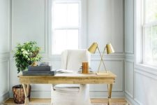 23 though the wall shade is neutral and pastal, a wooden desk makes the home office cozier
