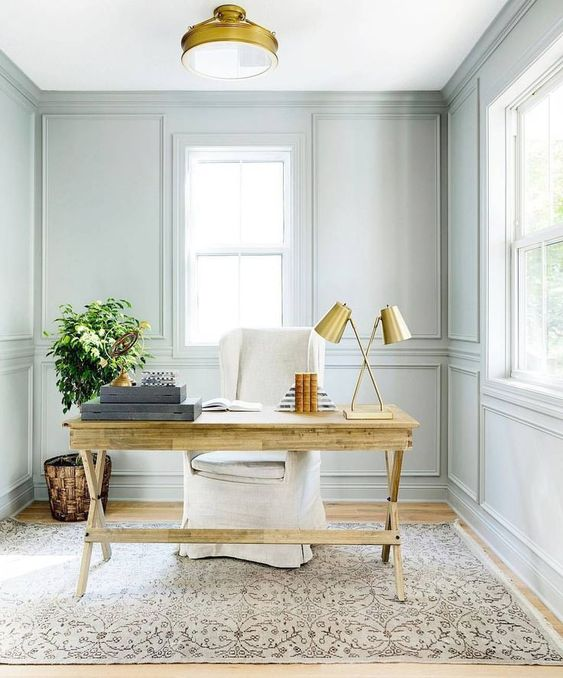 though the wall shade is neutral and pastal, a wooden desk makes the home office cozier
