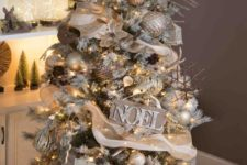 24 a rustic glam Christmas tree decorated with burlap, a vine deer head, wooden signs, stick snowflake ornaments and gold touches