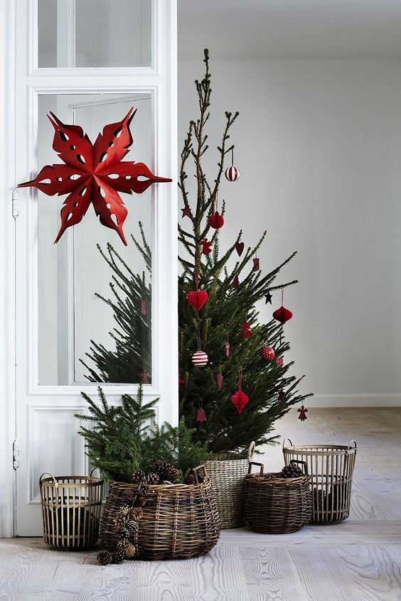 a small tree decorated with red and white ornaments is a gorgeous Scandinavian themed idea