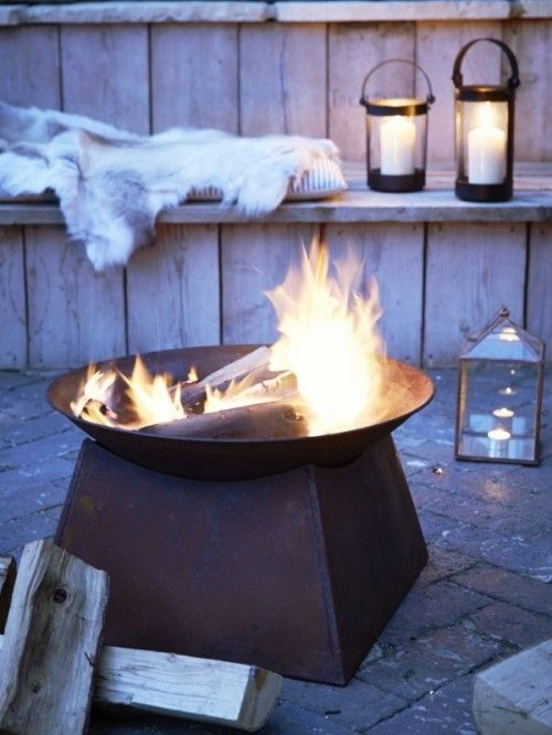 candle lanterns, pillows and faux fur, a large fire bowl are all you need for a hygge feeling