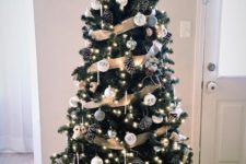 25 a rustic glam Christmas tree with white and silver ornaments, pinecones, icicle ornaments and lights