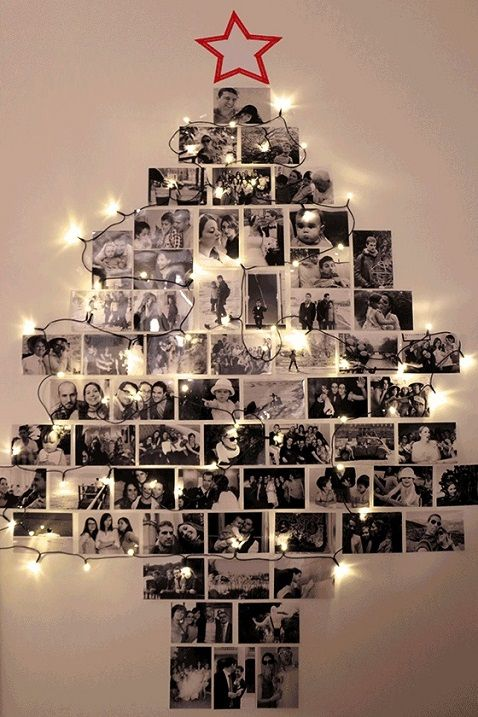 a wall-mounted Christmas tree made of photos and decorated with lights is a very personal and intimate idea