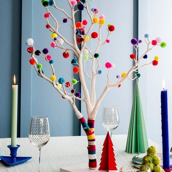 an alternative to a usual Christmas tree, whitewashed branches with colorful washi tape and pompoms