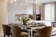 25 ceiling and pendant lamps and a chandelier illuminate the open layout