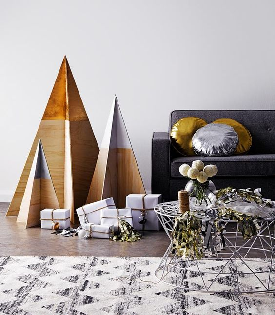 minimalist Christmas trees of plywood with dipped tops are all you need for a laconic interior