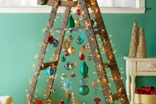 26 a fun Christmas tree of a laddder and colorful ornaments plus lights and a shiny star on top