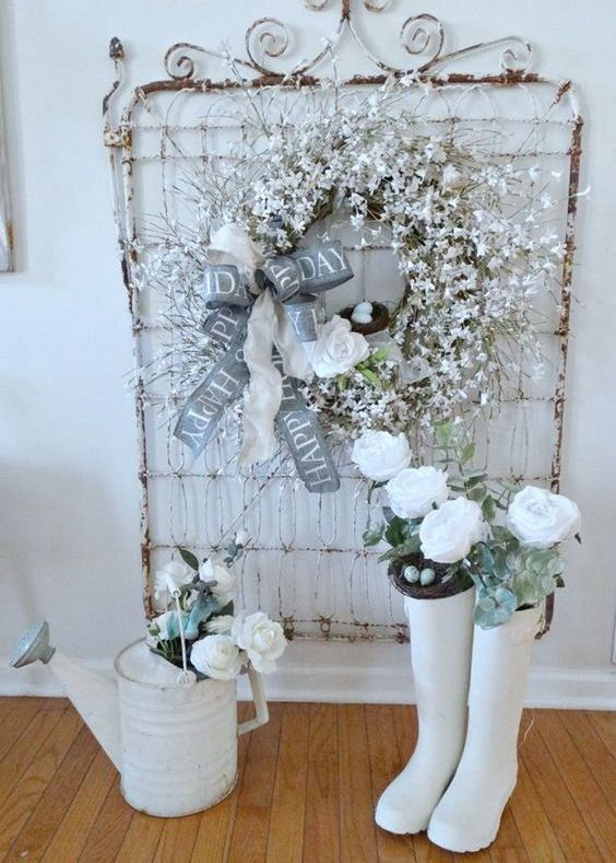 a snowy star branch wreath with a fake bird nest and a large ribbon bow and a fake bloom for shabby chic decor